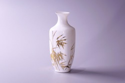 Antique Chinese Eggshell porcelain vase on grey color background. Golden bamboo leaves on White porcelain vase, famous Chinese antique pottery of Ming and Qing dynasties