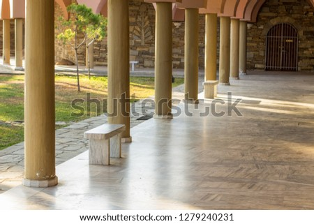 antique classic palace covered columns alley way and marble bench building landmarks concept
