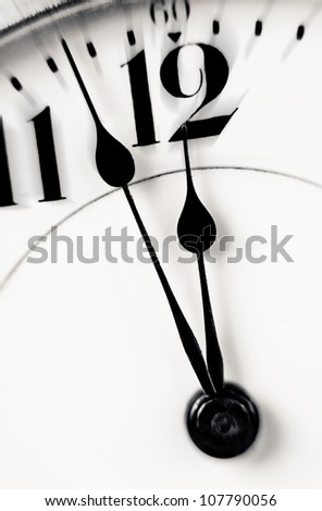 Antique clock closeup showing a few minutes to midnight. Concept of time,the past or deadline.