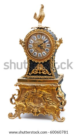 Antique clock with animals figurines isolated on white. Clipping path included.