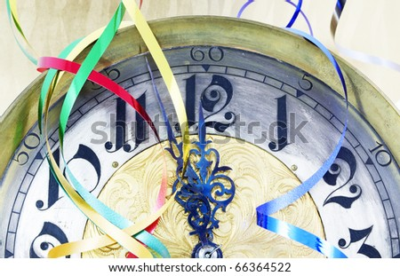 Antique clock with New Year ribbons