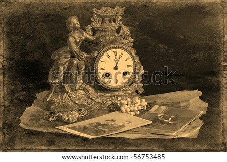 Antique clocks, jewelry and photographs on a dark background, stylized antique photos