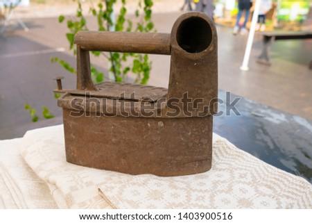 Antique coal iron. Old rusty iron
