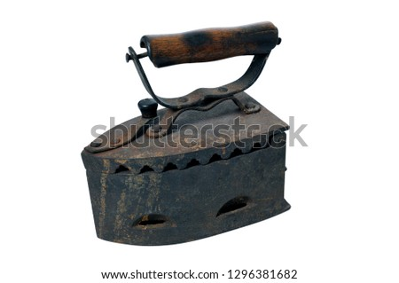 Antique coal iron. Old rusty iron is isolated on white background #1296381682