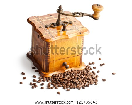 antique coffee mill with coffee beans
