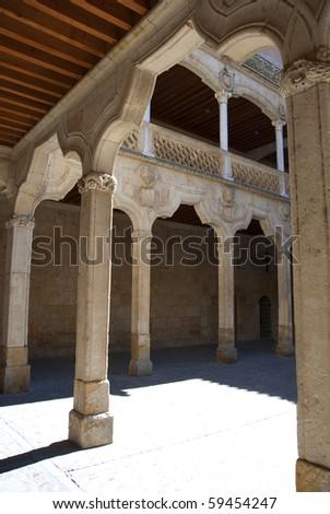 Antique colonnade courtyard in Casa de las Conchas. Salamanca. Spain