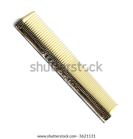 antique comb on a white...