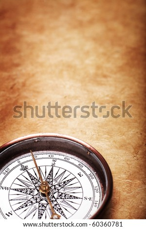 Antique compass on grunge background