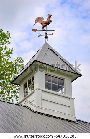 Antique Copper Rooster Weather Vane on top of a Cupola.