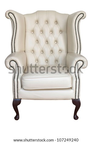 antique cream leather armchair isolated on white with clipping path