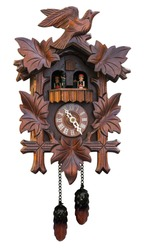 Antique cuckoo clock isolated on white