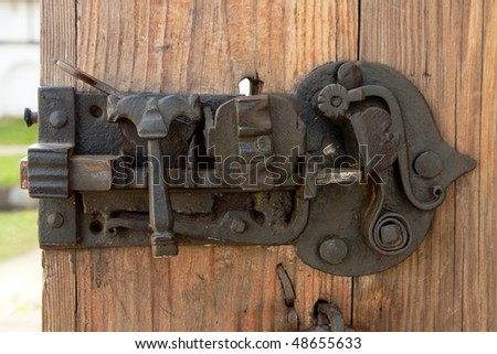 Antique door lock of the monastery, Russia - stock photo
