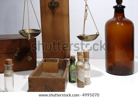 antique drugstore bottles and weighing scales