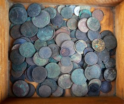 Antique European money on a junk dealer's tray, in a wooden box. Previously, it was wealth, but now the memory of the past history. Russia, half a penny. Kopeck.