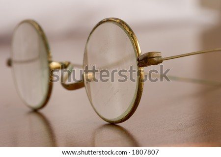 Antique eyeglasses with narrow depth of field - could be used to represent nearsightedness.