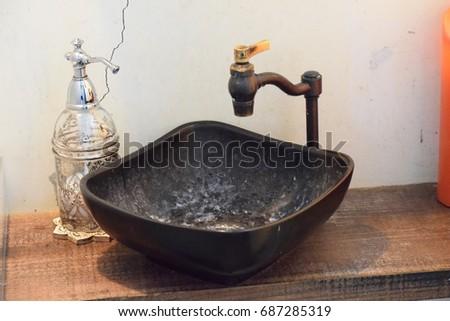 Antique faucet  #687285319