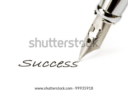 "Antique fountain pen writing the word ""success"" on white paper"