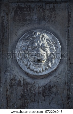 Antique fountain. Three Lion head coarsely. Fountain in the form of a lion's head. The image of a lion. Lion's Head. Old rusty fountain. Fountain in the form of an animal. Unique sculpture. Sculpture. #572206048