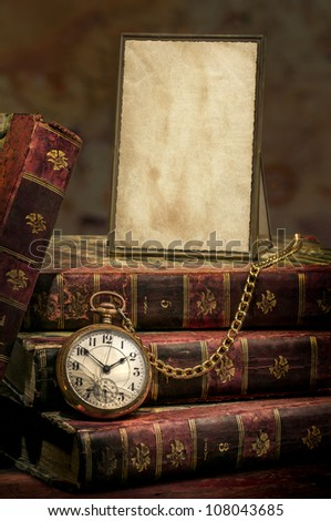 Antique Frame with old photo paper texture, Books and Pocket Clock.