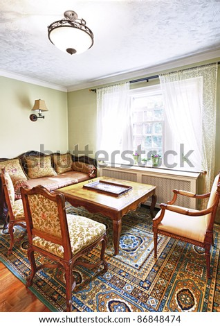 Antique furniture in living room interior of home