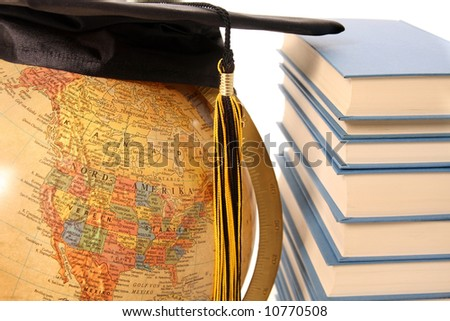 Antique globe, graduation cap and books on white background