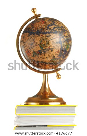 Antique globe on books isolated over white