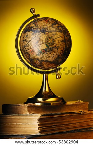 Antique globe on old books