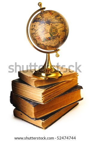 Antique globe on old books isolated over white