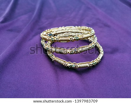 Antique gold  Bangle For Beautiful Hands on violet background #1397983709