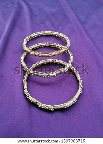 Antique gold  Bangle For Beautiful Hands on violet background #1397983715