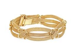 antique gold bracelet on white