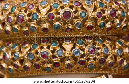 Antique gold bracelets with gemstones. Thai classical costume. #565276234