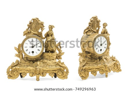 Antique gold colored table clocks on the white background. #749296963