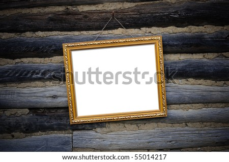Antique gold frame for the photo on the background wall of an old tree