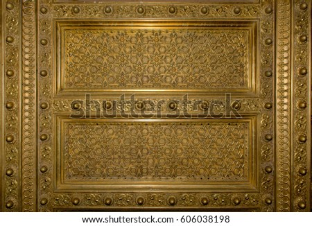 Antique gold plated wooden door frame from Jaipur City Palace #606038198