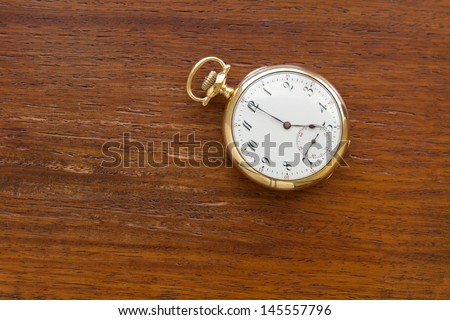 antique gold pocket watch at 5 o'clock.  Illustration of the passing of time, deadlines, history and tradition. - stock photo