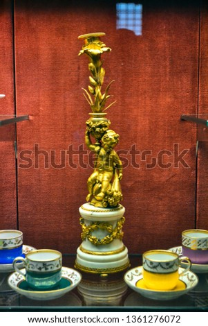antique gold statuette of a child with a jug and around the cup #1361276072