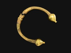 Antique golden bracelet called torc isolated on black background. Rigid neck ring or bracelet from Celts. Circa 1st to 2nd century BC. Galicia, Spain