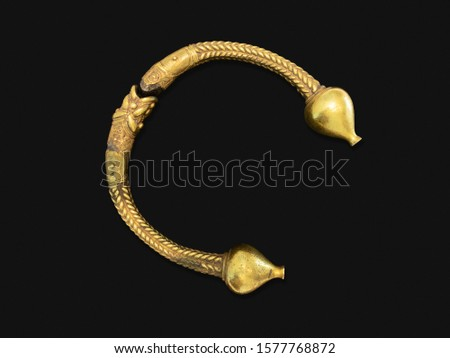 Antique golden bracelet called torc isolated on black background. Rigid neck ring or bracelet from Celts. Circa 1st to 2nd century BC. Galicia, Spain Stock photo ©