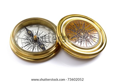Antique golden compass isolated on white background with soft shadow