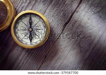 antique golden compass on wood...