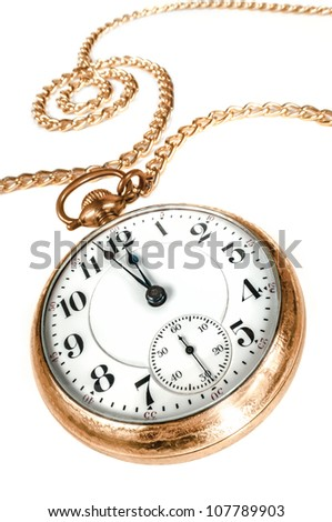 Antique golden pocket watch with chain, showing a few minutes to midnight isolated on white background. Concept of time,the past or deadline.