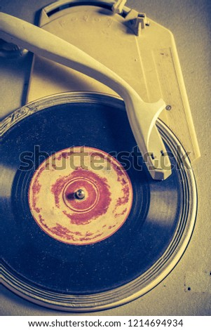 Antique gramophone and old vinyls with scratched #1214694934