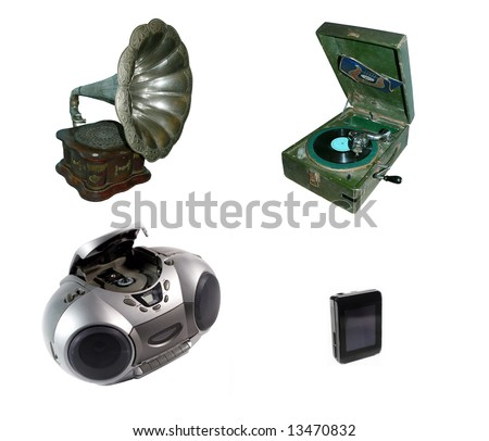 Antique gramophone, old record player, CD and cassette player, modern MP3 player (all isolated on white)
