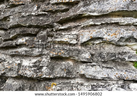 Antique gray stone wall close-up #1495906802
