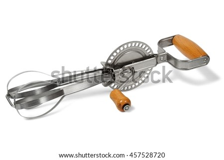 Antique hand mixer isolated on white background