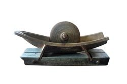 Antique Herb Grinding Tool,Antique metal trough for grinding herbal medicine isolated on white background with clipping path.