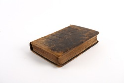 Antique historical books with visibly aged pages on a white background