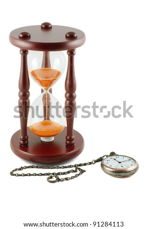 antique hourglass and a pocket watch isolated on white background