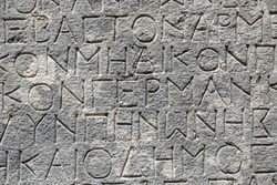 Antique inscription in ancient Greek on stone, fragment